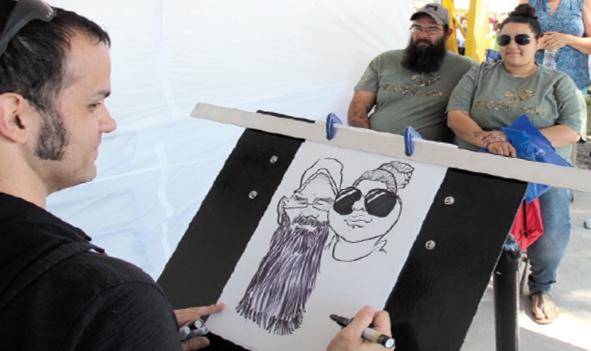 An artist sketches a couple