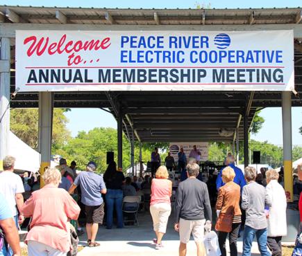 PRECO members walk under annual meeting banner