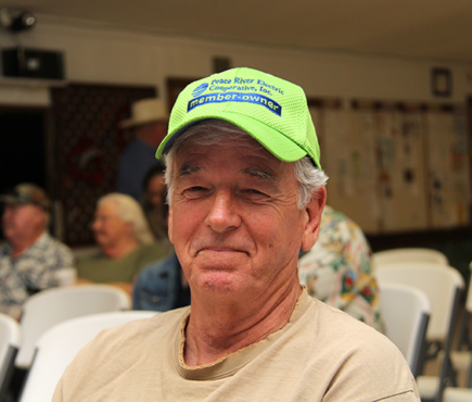 Man with lime green PRECO cap attends District Meeting