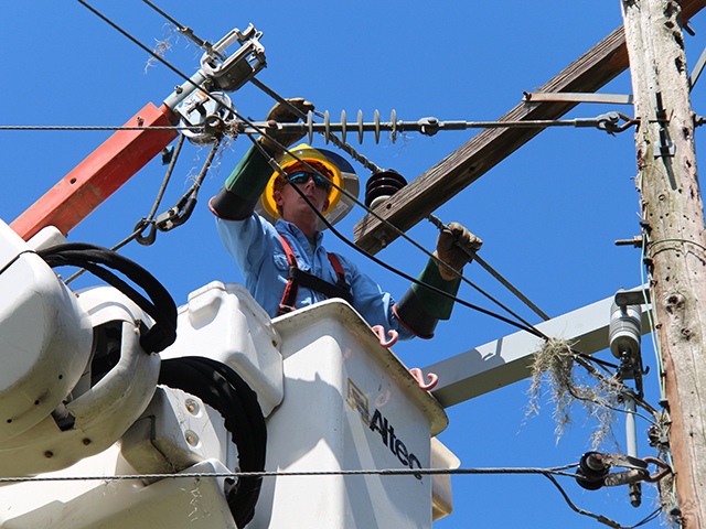 A lineman works on power lines