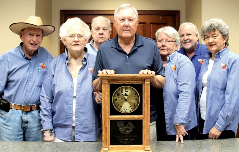 The Operation Round Up Board presents Tip Tharp with a clock commemorating his 13 years of service. Board members Bill Hodge, Pat Gugle, Bruce Behrens, Tip, Ellen Hamel, Mark Alexander and Winnie Wadsworth were present. Board members John Lipe and Mildred Smith were unavailable.