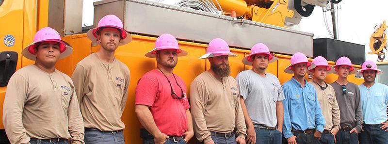 9 linemen with bucket truck